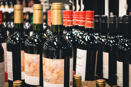 Bottles of red wine in store