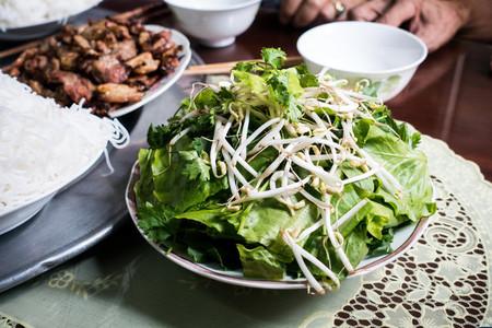 Bowl of fresh herbs and bean spr