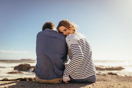 Couple sitting on a sea wall together