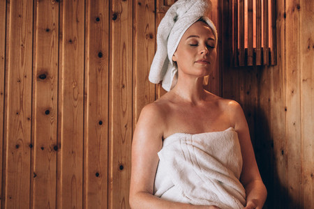 Woman sitting in a spa with eyes closed