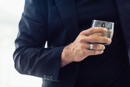 Businessman with a glass of whisky