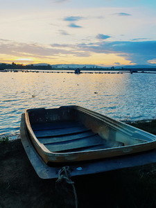 Wooden boat in a river  Sunset