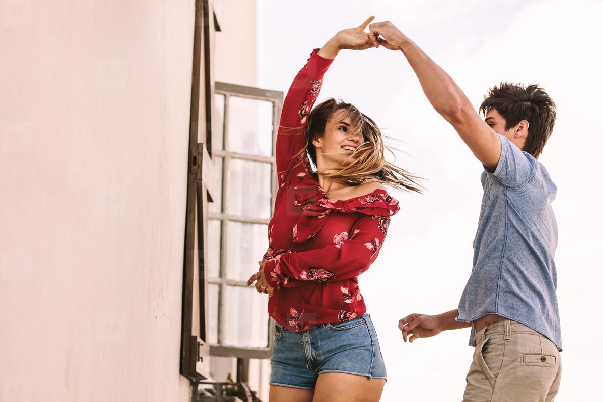 Couple dancing standing outdoors