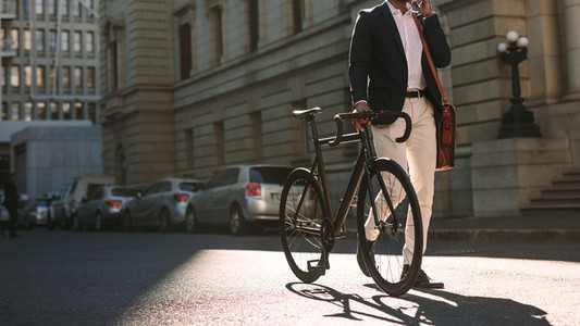 Man going to work with cycle using phone