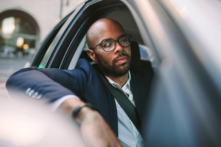 Businessman driving a car in city