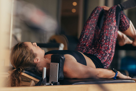 Pilates woman training in a gym