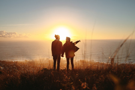 Silhouette of couple standing on mountain