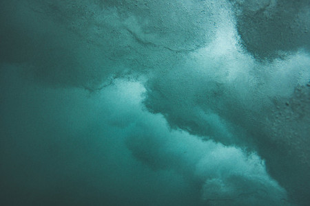 Underwater textures and bubbles of a wave in the ocean