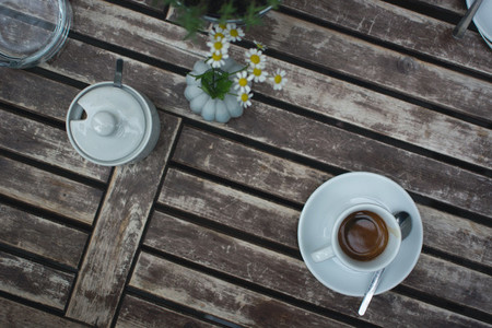Cup of espresso on wooden table