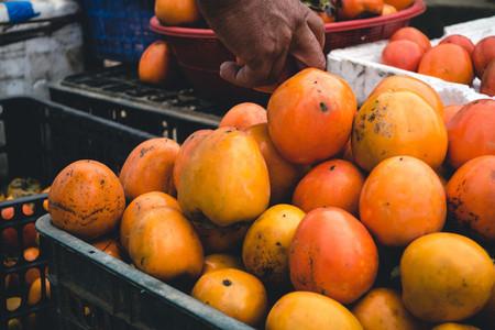 Crate of kaki fruits
