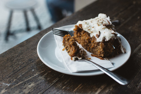 Eating carrot cake in a coffeesh