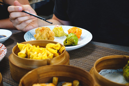 Eating chinese steamed and fried