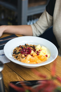 Eating granola with fresh fruits