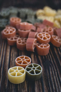 Colorful wheel pasta detail