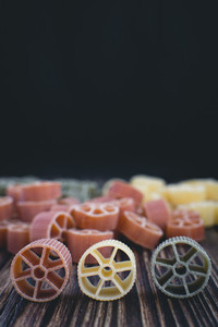Colorful wheel pasta detail