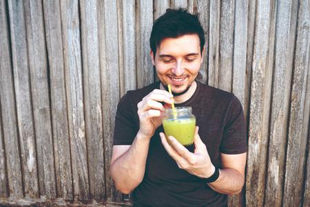 Young man drinking mojito