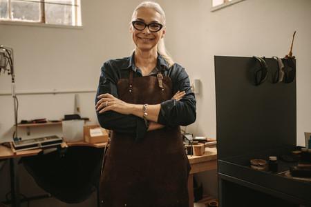 Portrait of confident senior female jeweler