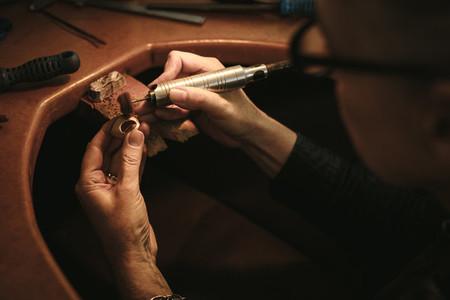 Jewelry designer polishing a ring