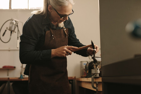 Senior jeweler shaping and designing a silver ring