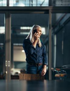 Female entrepreneur making a phone call