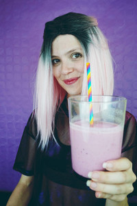 Fit woman drinking a smoothie