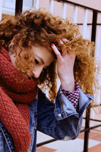 Beautiful redhead woman at fall