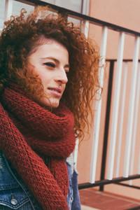 Beautiful redhead woman at fall