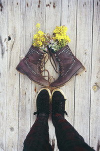 Old boots filled with flowers