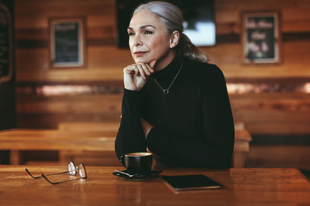 Thoughtful senior woman at coffee shop