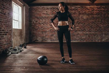 Woman taking break at fitness club