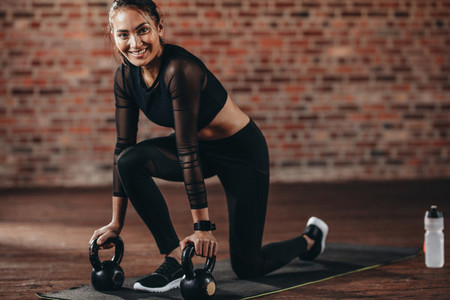 Gym woman doing exercise with kettle bell