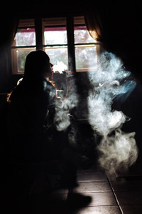 The girl smoke electronic cigarette