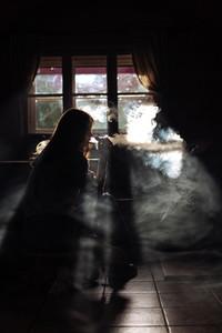 The girl smoke electronic cigarette