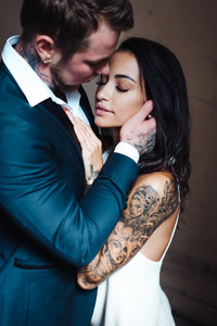 Beautiful young couple posing on camera indoors