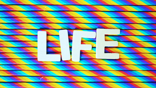 Life against rainbow background