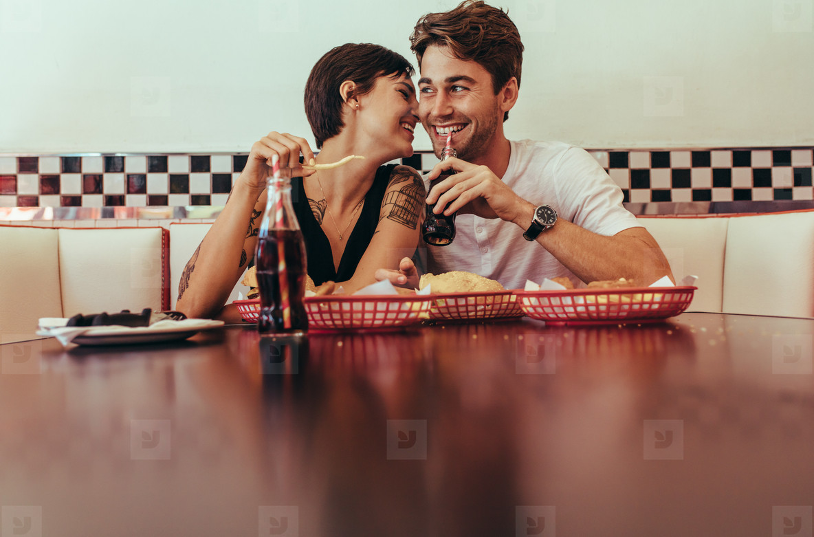 Happy couple at a restaurant eating food