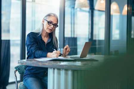 Senior businesswoman working at office