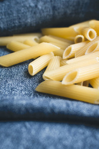 Pasta penne in a blue linen