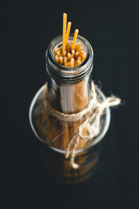 Pasta spaghetti in glass bottle