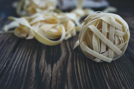 Pasta tagliatelle on a wooden