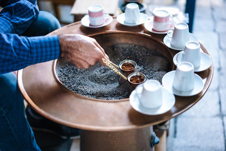 A man make Turkish coffee