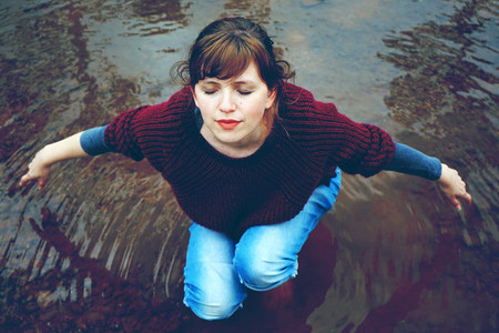 Young woman in a river