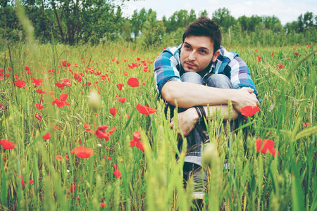Young man in a green field