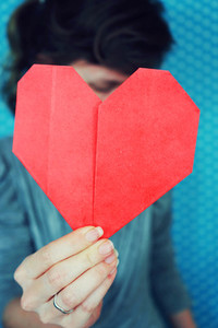 Woman holding a paper heart