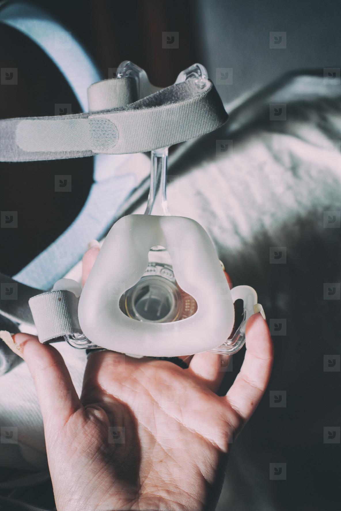 Hand holding oxygen mask