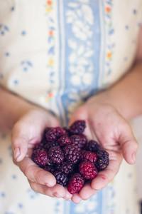 Woman holding blackberries