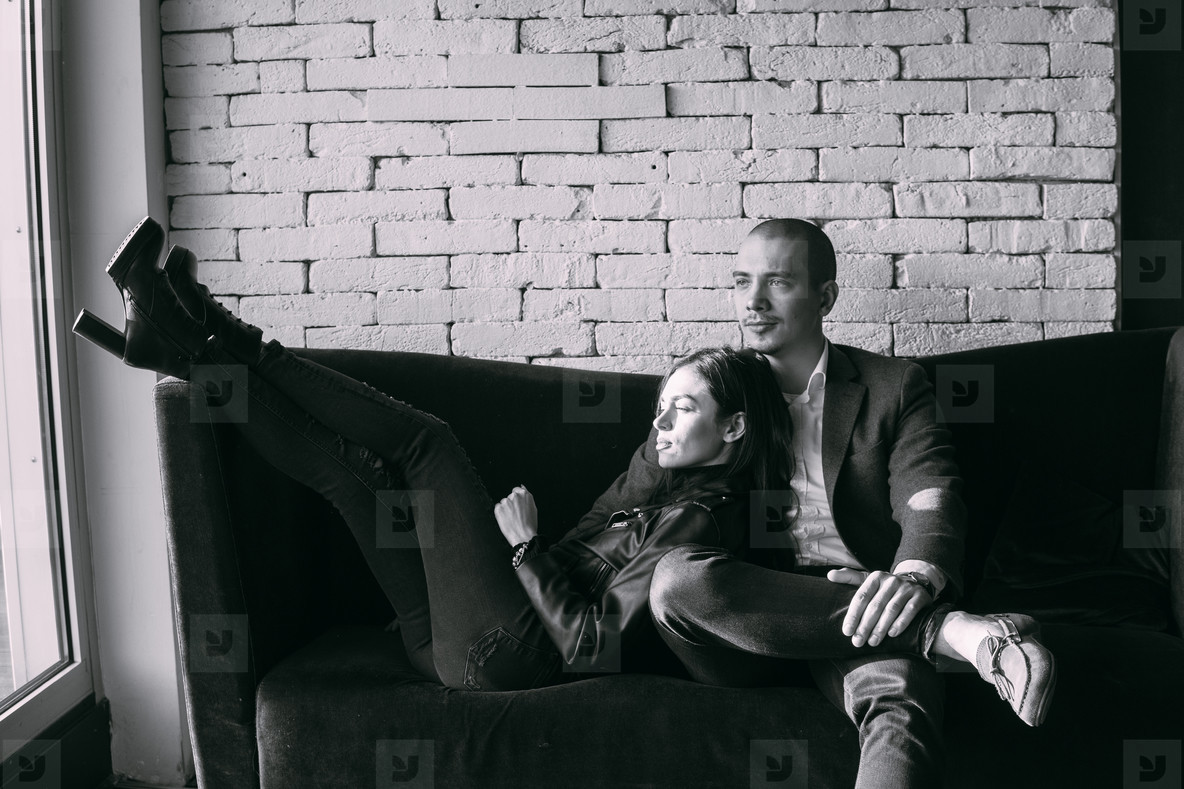 Happy couple sitting on a couch