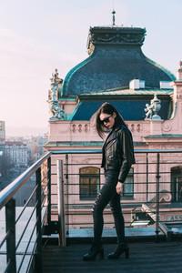 elegant girl posing at roof