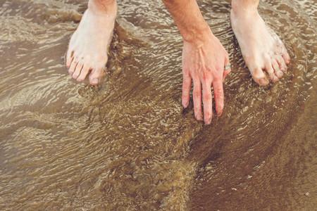 Touching sea water