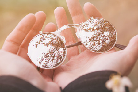 Hands holding sunglasses